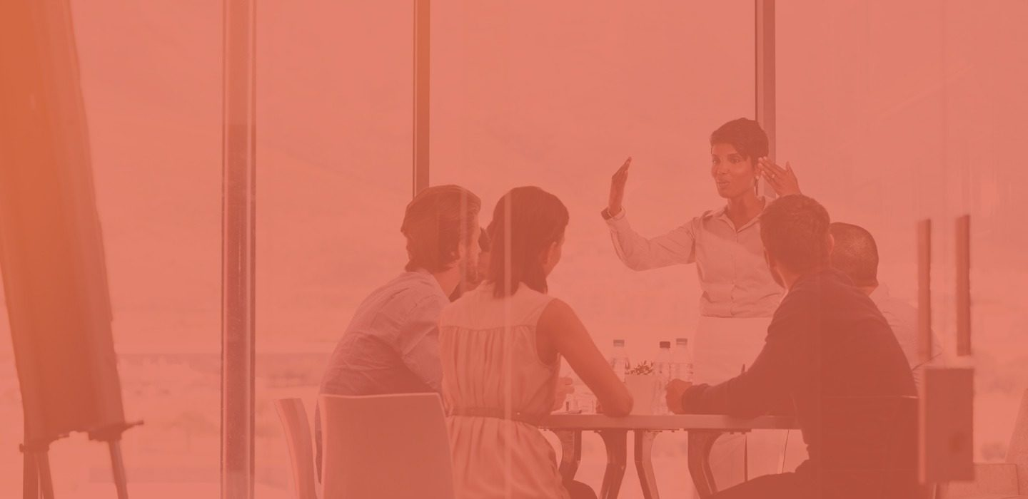 adjusting services image of a meeting with orange filter on top